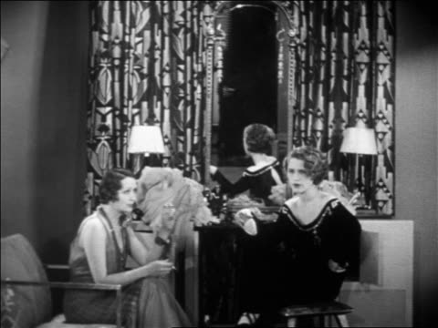 hedda hopper + norma shearer sitting in dressing room talking as man enters / feature - 1931 stock videos & royalty-free footage