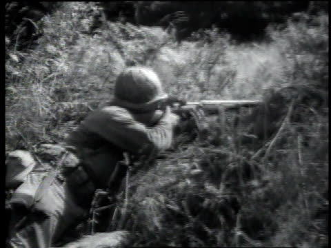 hedgerow fighting machine gun fires feeding magazine soldiers are crouching and firing rifles / normandy france - arromanches stock videos & royalty-free footage