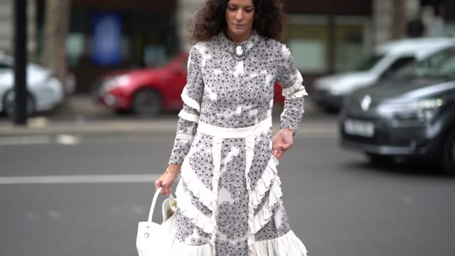 hedvig opshaug wears a dress with ruffles and floral prints a white bag white shoes during london fashion week september 2018 on september 14 2018 in... - floral pattern stock videos & royalty-free footage
