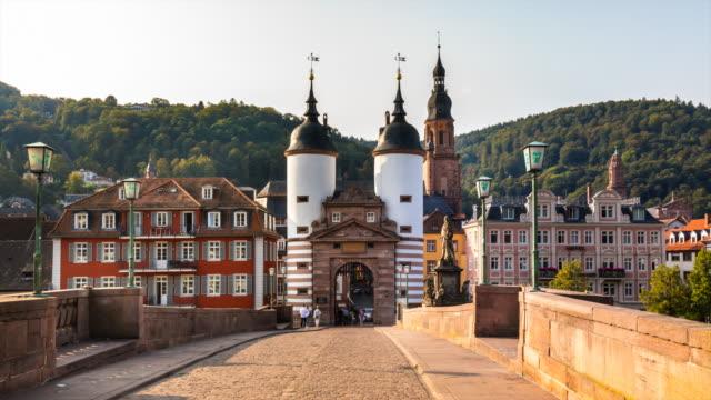 heidelberg alte brücke footbridge, city gate and old town, tl, ws - ハイデルベルク点の映像素材/bロール
