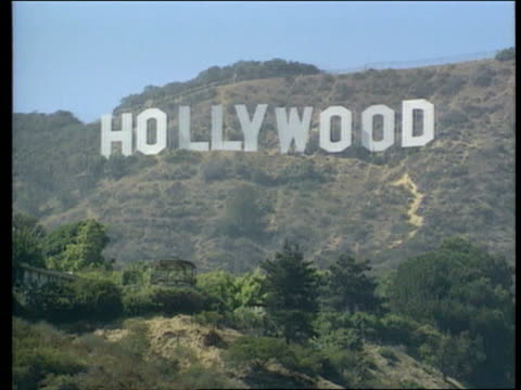 heidi fleiss prostitution conviction cr907 itn ms 'hollywood' in large letters on hillside past sign 'beverly hills hotel' - beverly hills hotel stock videos and b-roll footage