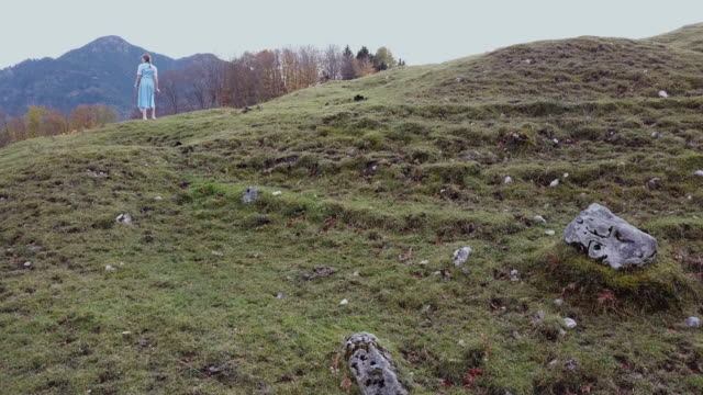 'heidi' girl in blue dress on a alpine meadow in autumn - one teenage girl only stock videos & royalty-free footage