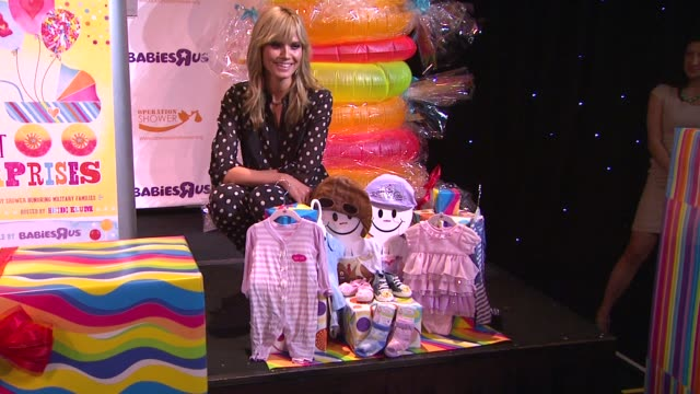 heidi klum at the babies r us throws a #trulyscrumptious operation shower event hosted by heidi klum at the globe theatre at universal studios on... - heidi klum stock videos and b-roll footage