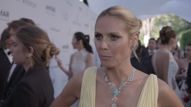 INTERVIEW Heidi Klum on being at AmfAR on the auction on the party at amfAR's 23rd Cinema Against AIDS Gala Arrivals at Hotel du CapEdenRoc on May 19...