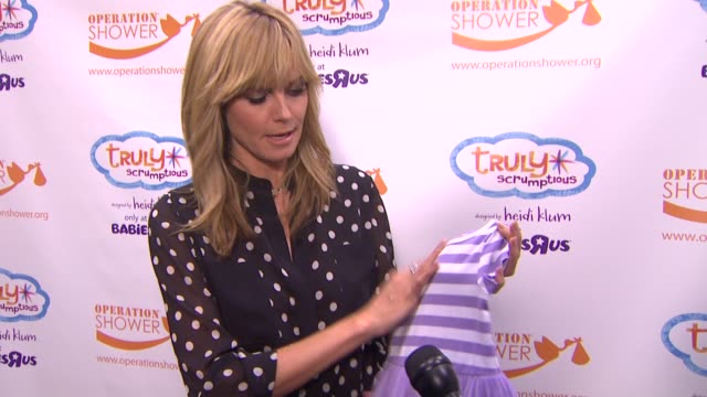 interview heidi klum on her truly scrumptious kids clothing line babies r us throws a #trulyscrumptious operation shower event hosted by heidi klum... - heidi klum stock videos and b-roll footage