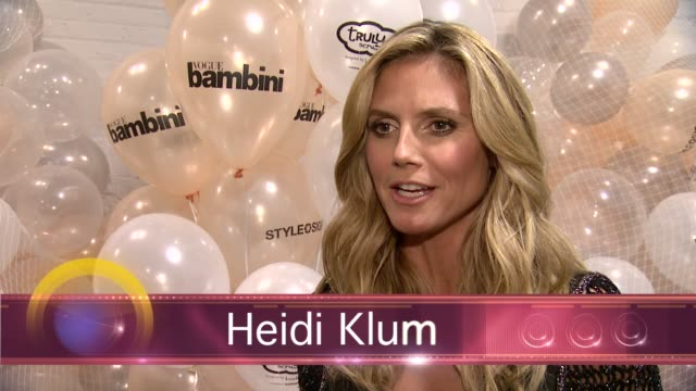 CHYRON Heidi Klum Presents Her Holiday Truly Scrumptious Collection For Babies'R'Us At Kids Fashion Week In NYC at Industria Studios on October 05...