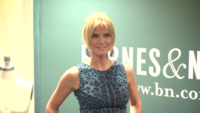 """heidi klum signs copies of """"project runway: the show that changed fashion"""" at barnes & noble, 5th avenue on july 13, 2012 in new york, new york - heidi klum stock videos & royalty-free footage"""