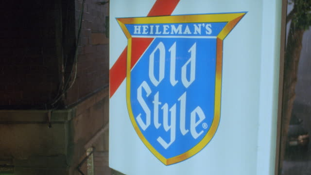 """a """"heileman's old style"""" beer sign hangs above the entrance to duffy's bar in chicago. - western script stock videos & royalty-free footage"""