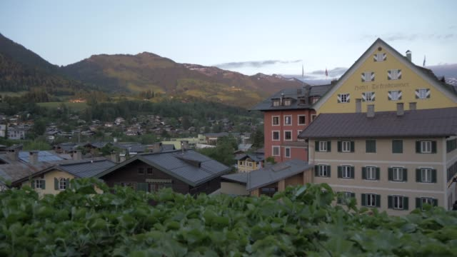 heiliger andreas rooftops at dusk, kitzbuhel, tyrol, austrian alps, austria, europe - north tirol stock videos & royalty-free footage