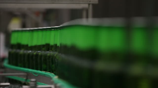 Heineken beer bottles move along conveyors at the Heineken NV brewery in Zoeterwoude Netherlands on Wednesday May 30 2018