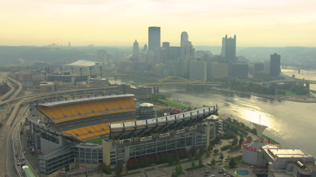 ws aerial ds heinz field football stadium with allegheny river and monongahela river at downtown / pittsburgh, pennsylvania, united states - pittsburgh video stock e b–roll