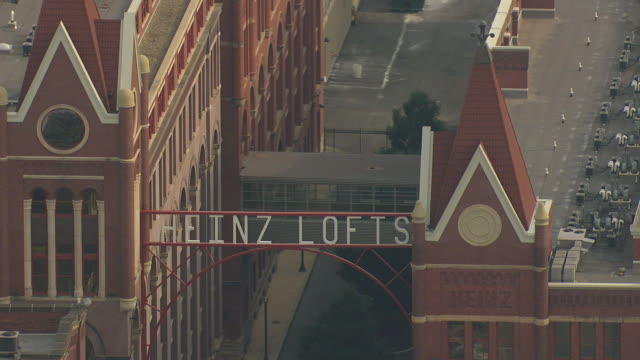 cu aerial heinz lofts with sign / pittsburgh, pennsylvania, united states - pittsburgh video stock e b–roll