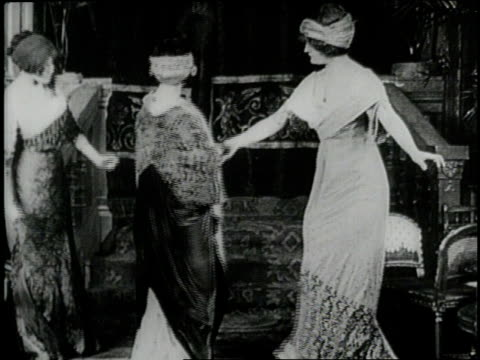 helen keller admires the millinery hats and paris fashions upon a visit to new york city in 1910 - 1910 stock-videos und b-roll-filmmaterial