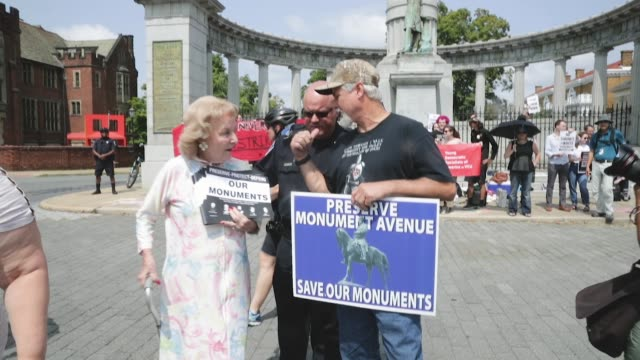 helen marie taylor who supports the of conservation of confederate monuments is ushered away from counter protesters as they rally at the jefferson... - monument stock videos & royalty-free footage