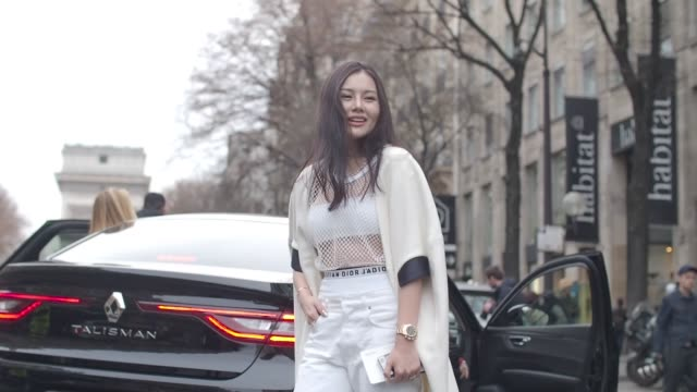 helen miao wears a mesh white top, white bras, a white cape, dior white denim jeans pants, a golden watch, and boots, outside the undercover show,... - mesh textile stock videos & royalty-free footage