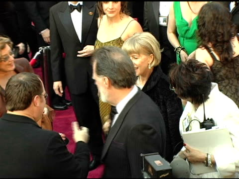 Helen Mirren and Taylor Hackford at the 2005 Annual Academy Awards Arrivals at the Kodak Theatre in Hollywood California on February 28 2005