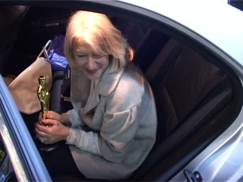 helen mirren flies into heathrow and sits in car holding her oscar awarded as best actress for 'the queen' - personal land vehicle stock videos & royalty-free footage