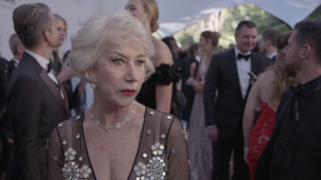 INTERVIEW Helen Mirren on being at amfAR on Leonardo DiCaprio auctioning his house at amfAR's 23rd Cinema Against AIDS Gala Arrivals at Hotel du...