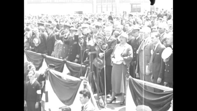 Helen Schafer sings The Star Spangled Banner at the opening ceremony for Floyd Bennett Field in Brooklyn New York City Mayor Jimmy Walker stands...
