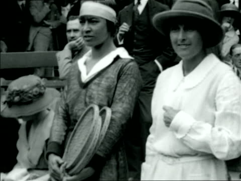 vídeos de stock e filmes b-roll de helen wills + molla mallory stand side-by side / documentary - raqueta