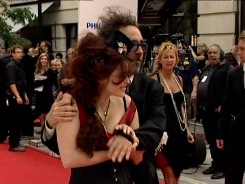 Helena Bonham Carter and Tim Burton pose of the photographers at the BAFTA awards in London 7th June 2010