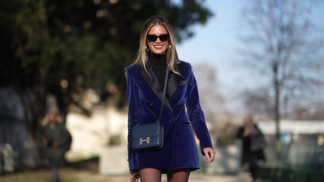 helena bordon wears sunglasses, earrings, a blue long jacket/dress, a turtleneck top, a hermes bag, fishnet tights, black long leather boots, outside... - black colour stock videos & royalty-free footage