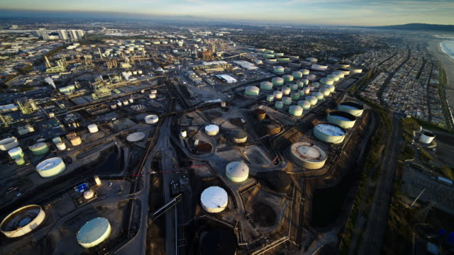 Helicopter aerial of Chevron Oil Refinery and Tank Farm, El Segundo, near Los Angeles, CA, in late afternoon