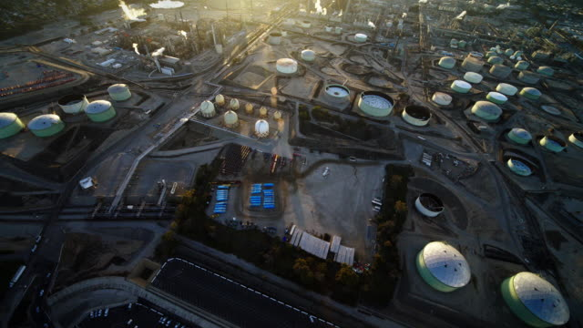 helicopter aerial of chevron oil refinery and tank farm, el segundo, near los angeles, ca, in late afternoon - el segundo stock videos and b-roll footage