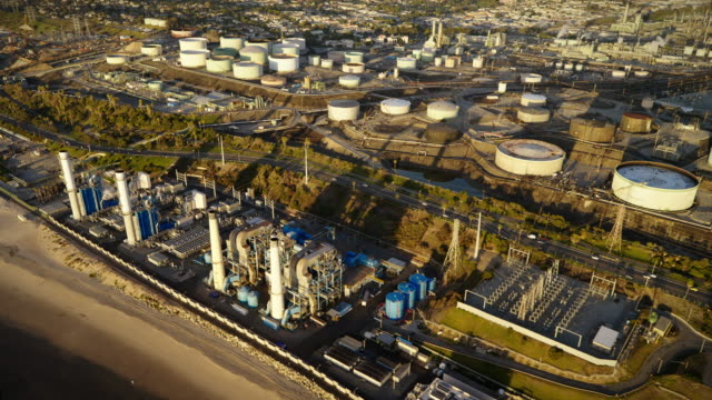 helicopter aerial of chevron oil refinery, power plant, and tank farm, el segundo, near los angeles, ca, in late afternoon - el segundo stock videos & royalty-free footage