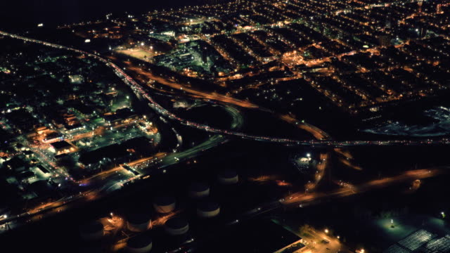 helicopter aerial shot of highway traffic at night