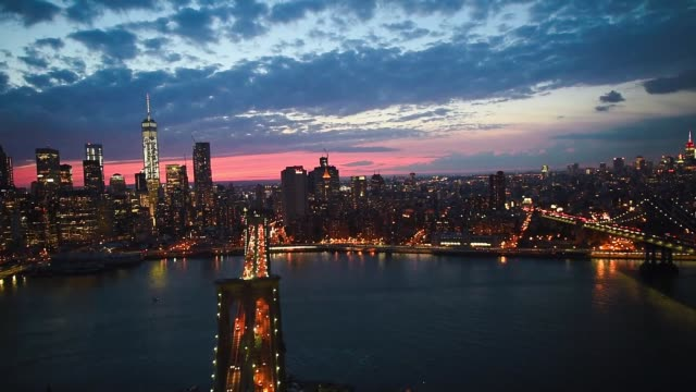 helicopter aerial shots over new york city look down at the brooklyn bridge and manhattan bridge at night on june 18th 2015 shots aerial shots fly... - manhattan new york city stock videos & royalty-free footage