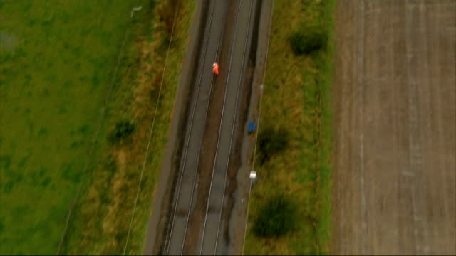 helicopter aerials of floods in north east england empty railway tracks including workers walking along tracks / darlington station with trains on... - darlington north east england stock videos & royalty-free footage
