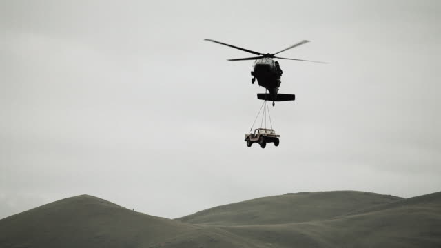 helicopter  bringing a humvee down to land - black hawk helicopter stock videos and b-roll footage