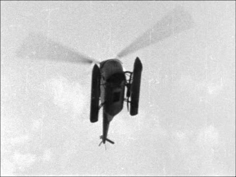 helicopter bus service in london stops england london south bank ext wide shot airport terminal / helicopter coming into land / mother with two young... - helicopter landing pads stock videos and b-roll footage