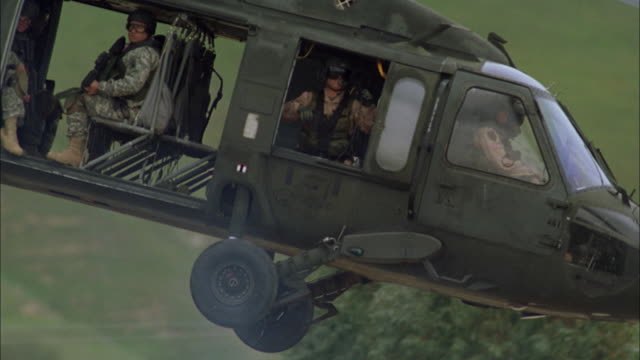 ms, ts, helicopter carrying soldiers lifting off from mountain side, usa - army soldier stock videos & royalty-free footage