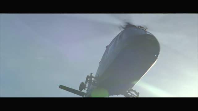 ms la helicopter circling low over camera - helicopter landing stock videos & royalty-free footage