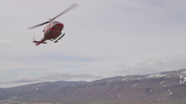 helicopter comes in to land on tundra, greenland - propeller stock videos and b-roll footage
