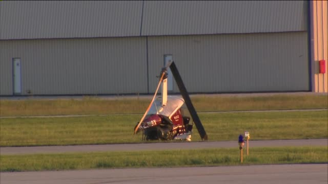 wgn helicopter crashes during training exercise on june 03 2013 in lansing illinois - lansing stock-videos und b-roll-filmmaterial