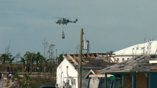 a helicopter delivering aid to victims of hurricane dorian on abaco islands in the bahamas - bahamas stock videos & royalty-free footage