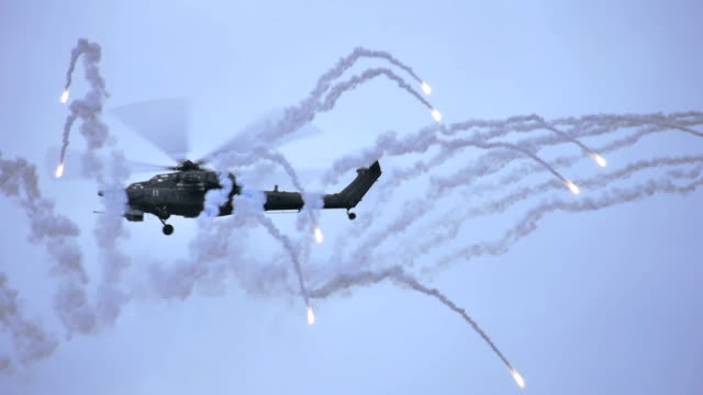 helicopter firing heat flares - military helicopter stock videos and b-roll footage