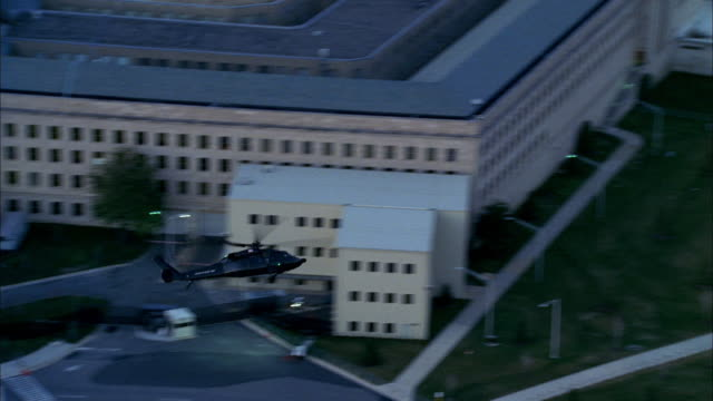a helicopter flies low around the pentagon. - united states department of defense stock videos & royalty-free footage