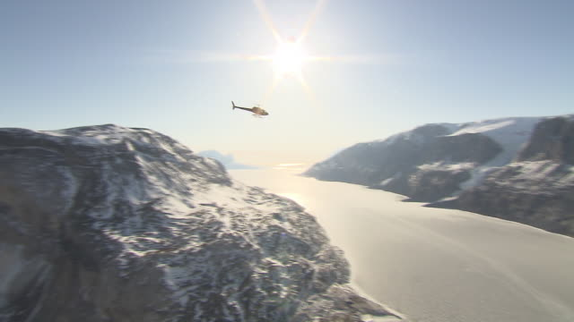 A helicopter flies over Disko Bay in Greenland.