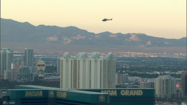 a helicopter flies over downtown las vegas. - helicopter tour stock videos and b-roll footage
