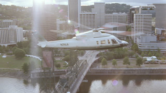 a helicopter flies over downtown portland, oregon. - fiume willamette video stock e b–roll