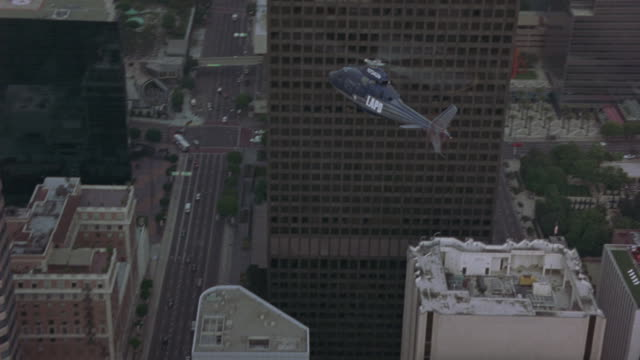 a lapd helicopter flies over downtown. - los angeles police department stock videos & royalty-free footage