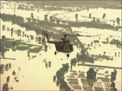 helicopter flies over flooded land following pakistan floods - 2010 video stock e b–roll