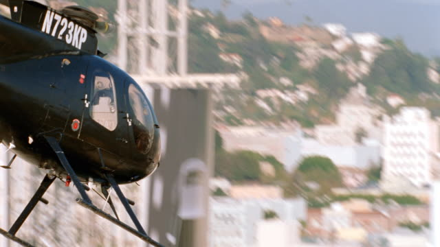 a helicopter flies over hollywood, california - helicopter stock videos & royalty-free footage