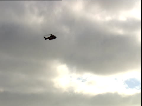 Helicopter flies over oil rig