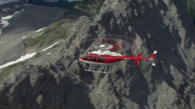 helicopter flies over sundance range in canada - helicopter stock videos & royalty-free footage