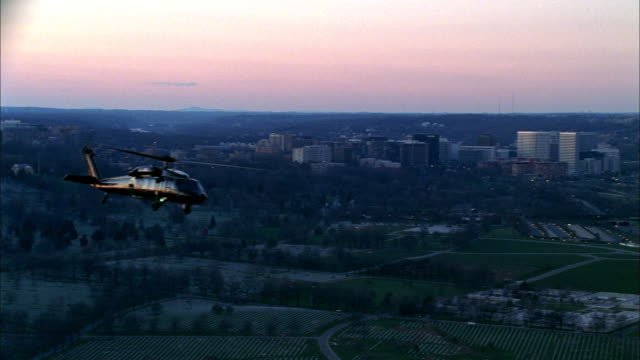 a helicopter flies over the pentagon. - arlington virginia stock videos & royalty-free footage